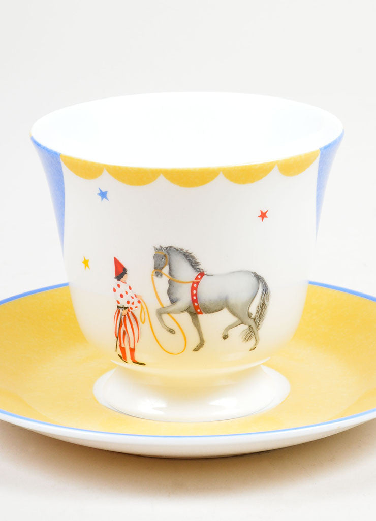 "White, Yellow and Blue Hermes Porcelain ""Le Clown Dresseur"" Circus Teacup & Saucer Front 2"