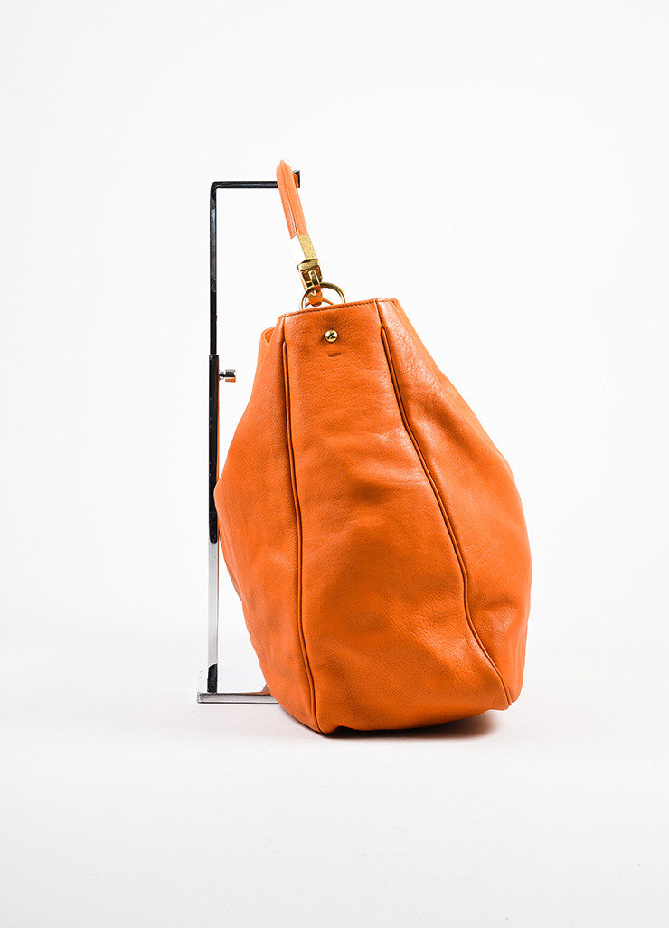 "Yves Saint Laurent Orange Leather ""Roady"" Tote Bag Sideview"