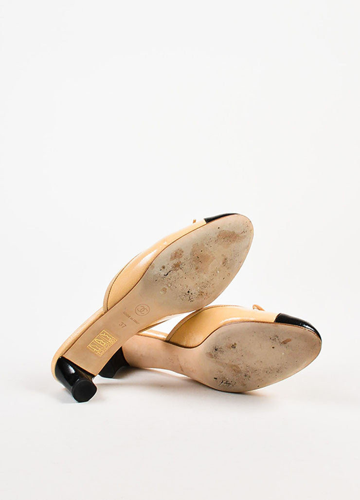 Chanel Beige and Black Patent Leather Cap Toe Bow Detail Mules Outsoles
