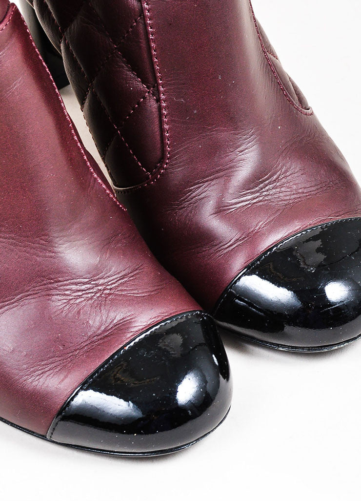 Maroon and Black Chanel Quilted Leather Patent Cap Toe Wedge Booties Detail