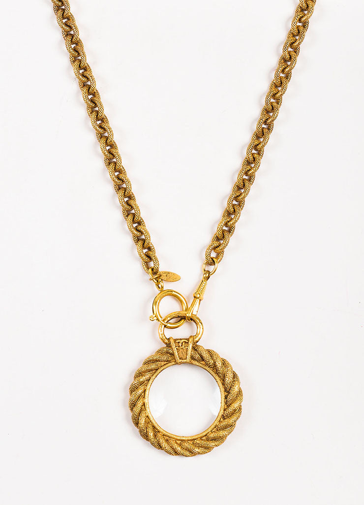 Gold Tone Chanel Etched Magnifying Glass Pendant Necklace Front