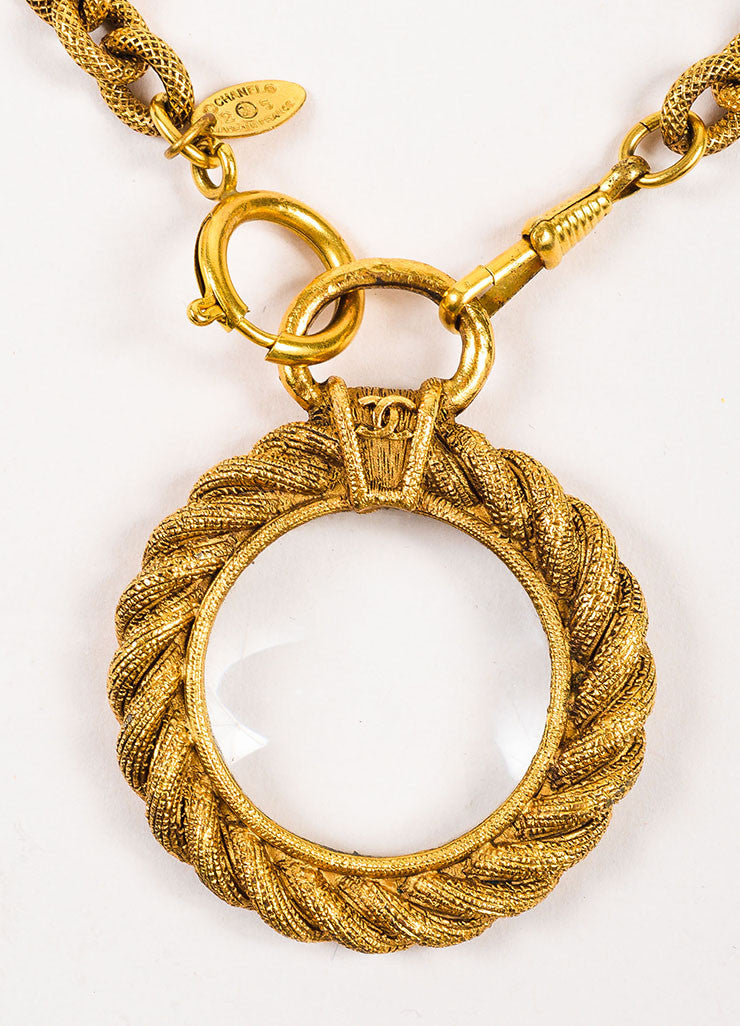 Gold Tone Chanel Etched Magnifying Glass Pendant Necklace Detail