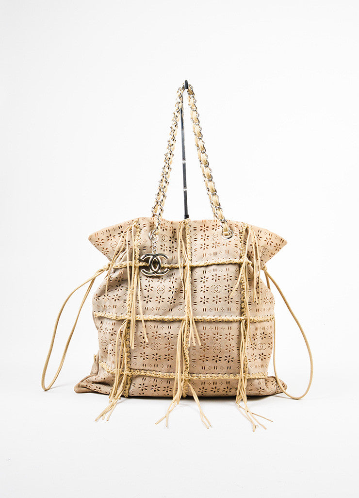 Tan Chanel Perforated Laser Cut Woven Fringe Drawstring Tote Bag Frontview