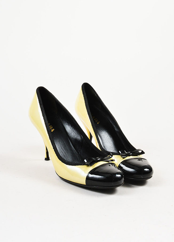 Pale Yellow Prada Patent Leather Cap Toe Bow Pumps Front