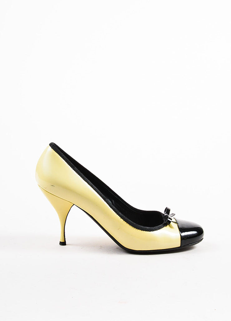 Pale Yellow Prada Patent Leather Cap Toe Bow Pumps Side