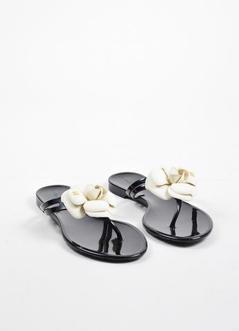 Chanel Black, Cream, and Gold Toned Rubber Camellia Flower Thong Sandals Frontview