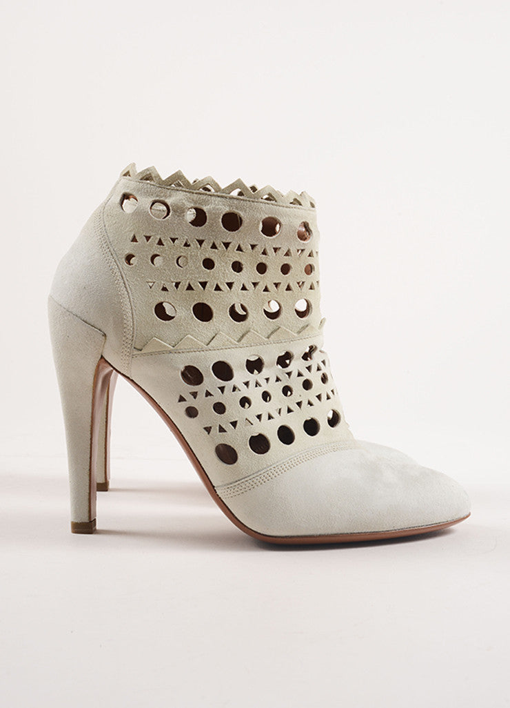 Alaia Cream Suede Cut Out Zip Heeled Ankle Boots Sideview