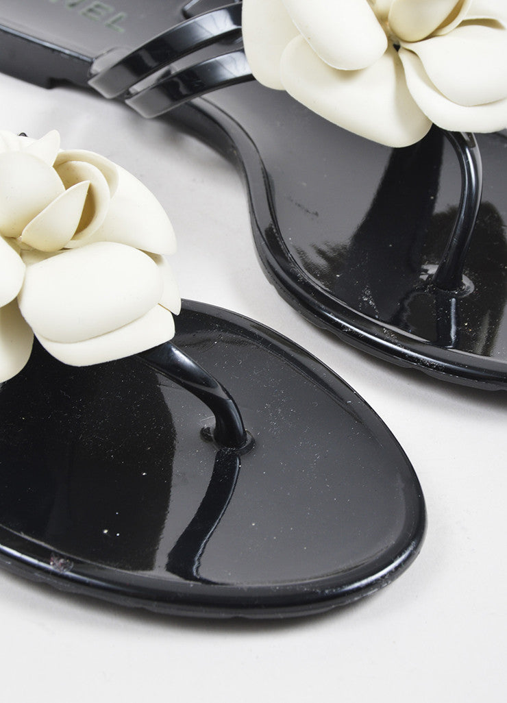 Chanel Black, Cream, and Gold Toned Rubber Camellia Flower Thong Sandals Detail