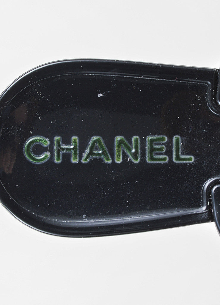 Chanel Black, Cream, and Gold Toned Rubber Camellia Flower Thong Sandals Brand