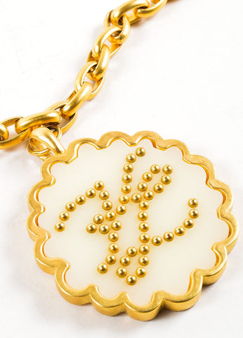 "Gold Toned Acrylic Karl Lagerfeld ""KL"" Initial Scalloped Pendant Necklace Detail"