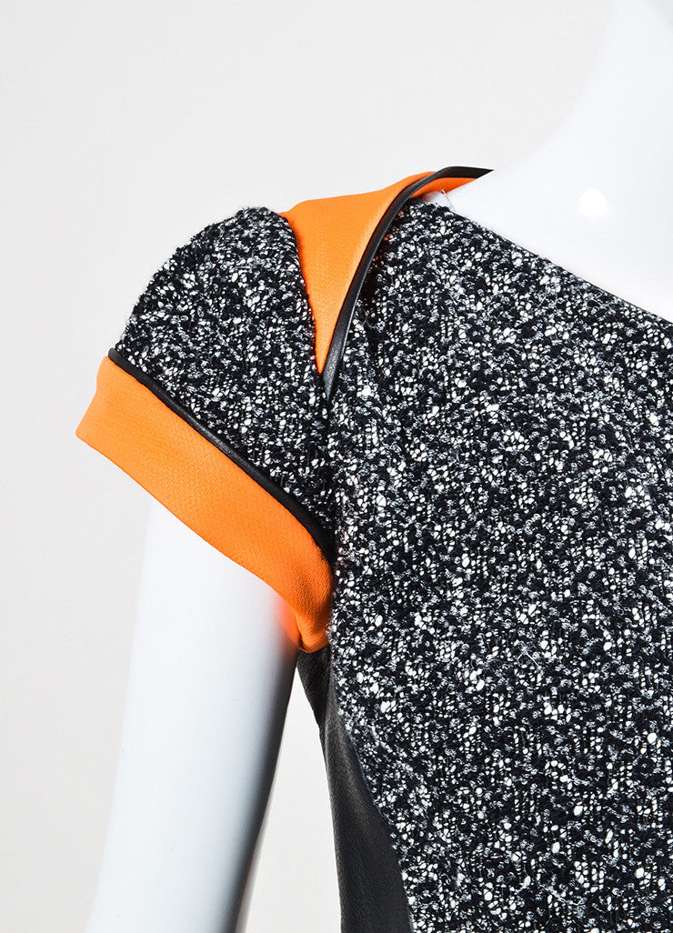 Antonio Berardi Black, White, and Orange Cotton and Faux Leather Cinched Short Sleeve Jacket Detail