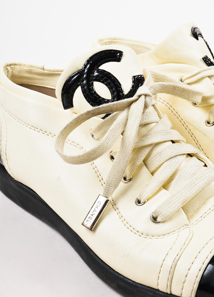 "Chanel ""Blanc"" White and Black Patent Leather Cap Toe 'CC' Sneakers Detail"