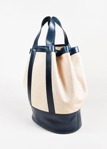 Hermes Tan and Navy Leather Trimmed Canvas Bucket Bag Sideview
