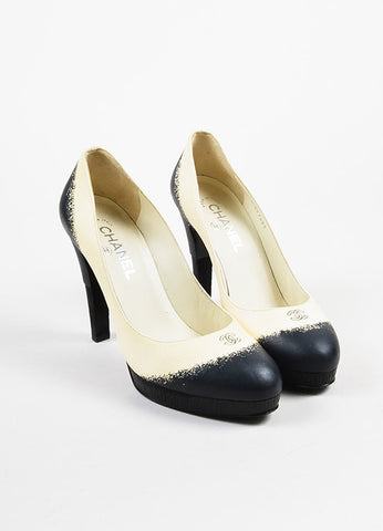Chanel Cream, Black, and Blue Leather Textured Heel and Platform Pumps Frontview