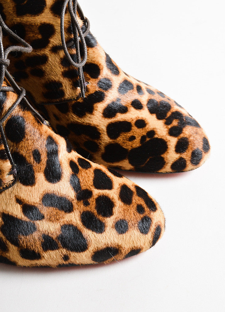 Christian Louboutin Black and Brown Leopard Print Wedge Tie Up Booties Detail