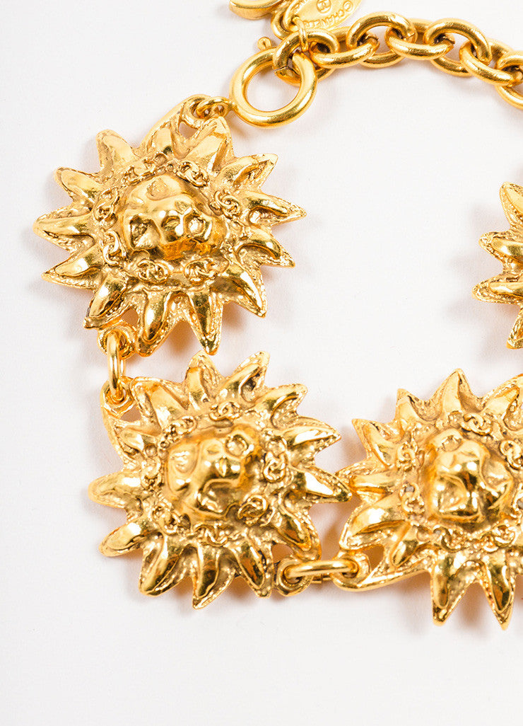 "Chanel Gold Toned Metal Lion Head Sunburst ""CC"" Charm Link Bracelet Detail"