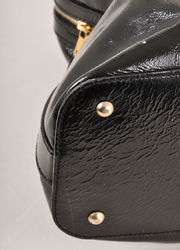 "Yves Saint Laurent Black and Gold Toned Patent Leather Oversized ""Muse"" Bag Detail"