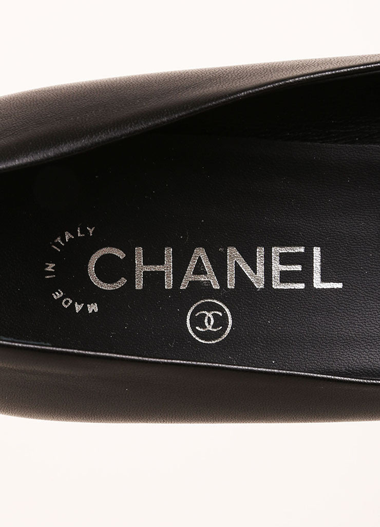 Chanel Black Leather and Silver Toned Stripe Cap Toe Pumps Brand
