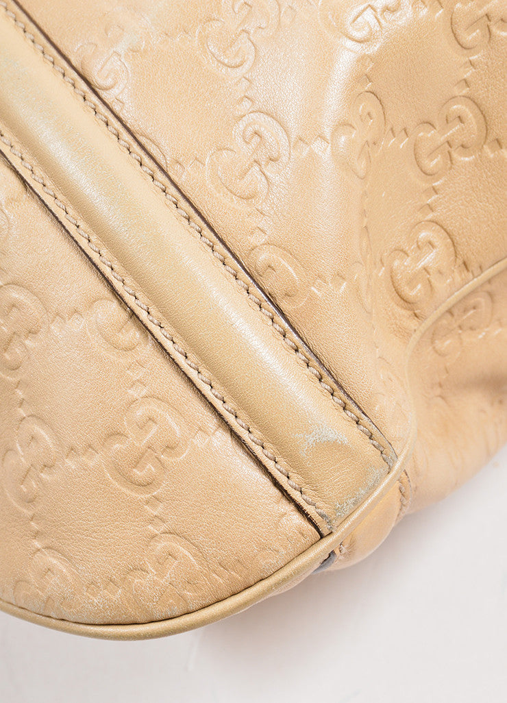 Gucci Tan Leather Embossed 'GG' Logo Hobo Bag Detail