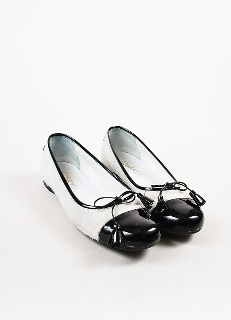 White and Black Chanel Pony Hair Cap Toe Ballet Flats Front