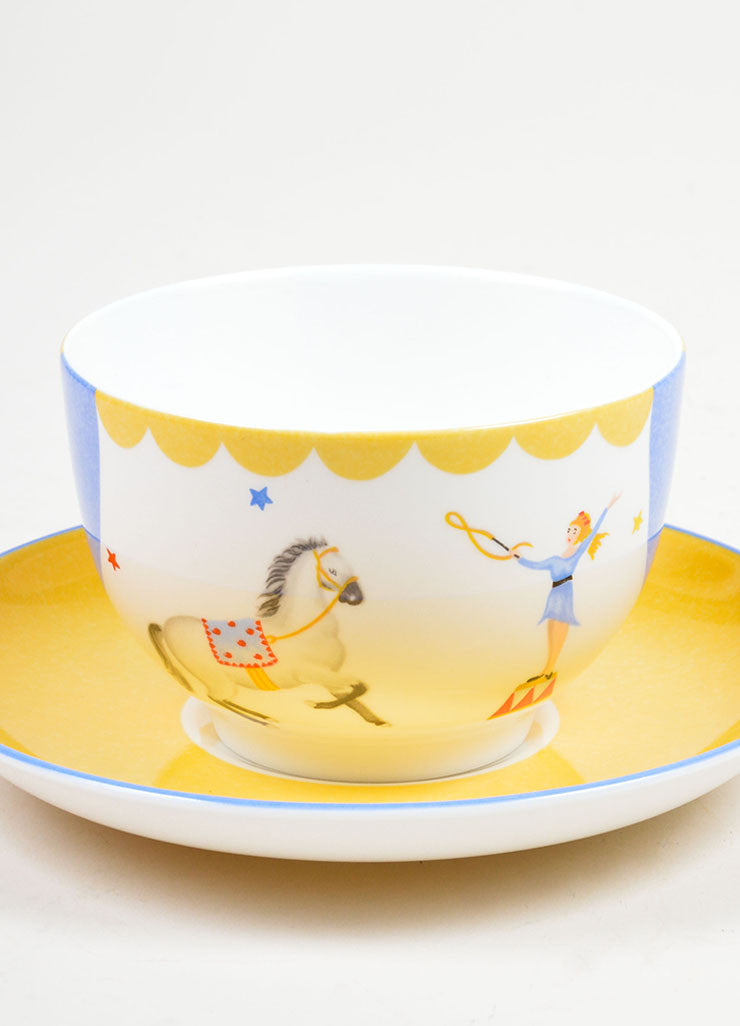 "White, Yellow and Blue Hermes Porcelain ""Le Dompteur"" Circus Print Teacup and Saucer Detail"