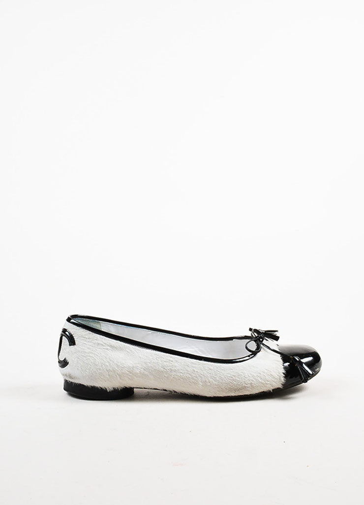 White and Black Chanel Pony Hair Cap Toe Ballet Flats Side