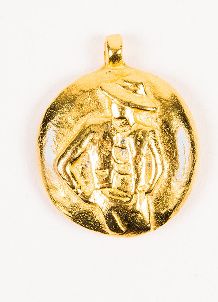 "•ÈÀChanel Gold Toned Metal ""Chanel"" Word Posing Figure Circle Pendant Charm Frontview"