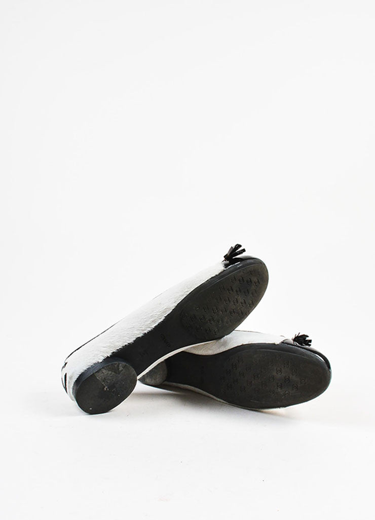 White and Black Chanel Pony Hair Cap Toe Ballet Flats Sole