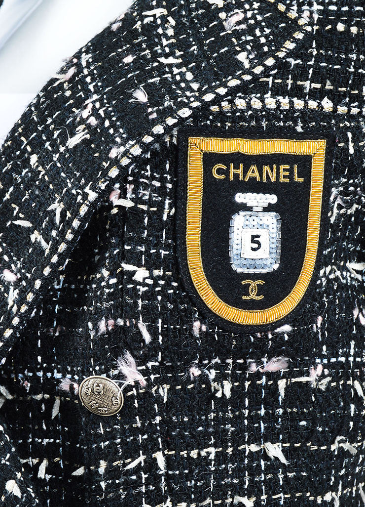 "Black, White, and Pink Chanel Cotton Blend Tweed ""No. 5"" Bottle Emblem Coat Detail"