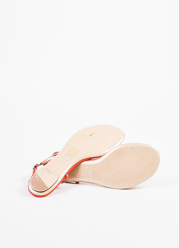 Valentino Garavani Red Leather Rosette Flat Sandals Outsoles
