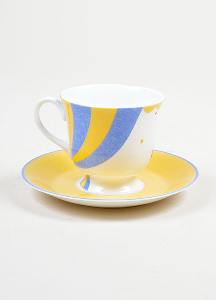 "White, Yellow and Blue Hermes Porcelain ""Le Clown Cavalier"" Circus Teacup and Saucer Frontview"