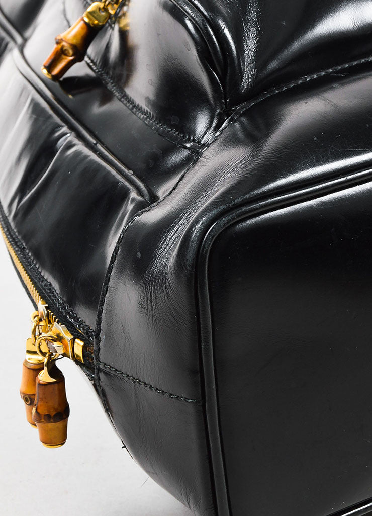 Black Patent Leather and Bamboo Accent Sling Backpack Detail