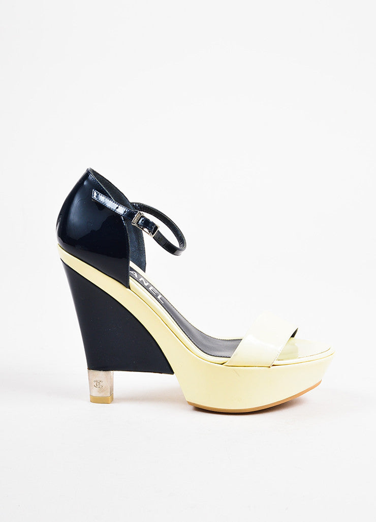Chanel Navy, Cream, and Silver Toned Heel Cap Patent Leather Platform Wedge Heels Sideview