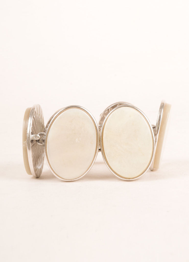 Yves Saint Laurent Silver Toned and Cream Flat Stone Face Oval Bracelet Frontview