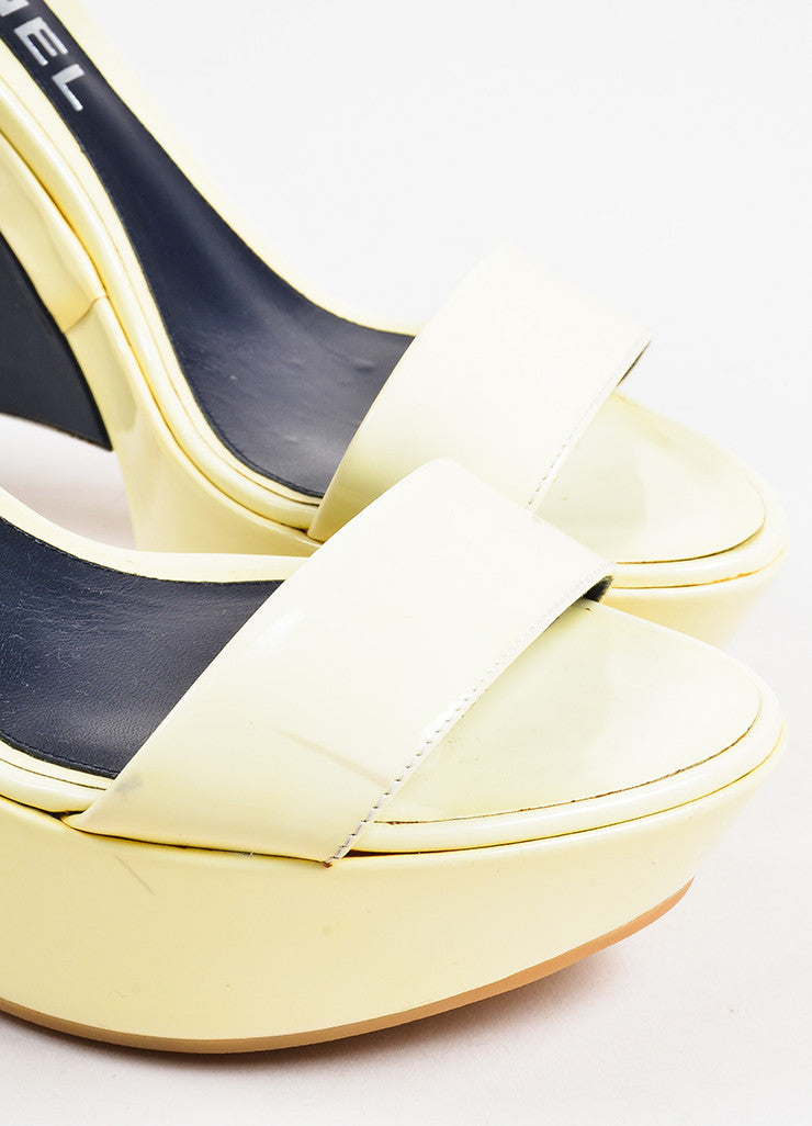 Chanel Navy, Cream, and Silver Toned Heel Cap Patent Leather Platform Wedge Heels Detail
