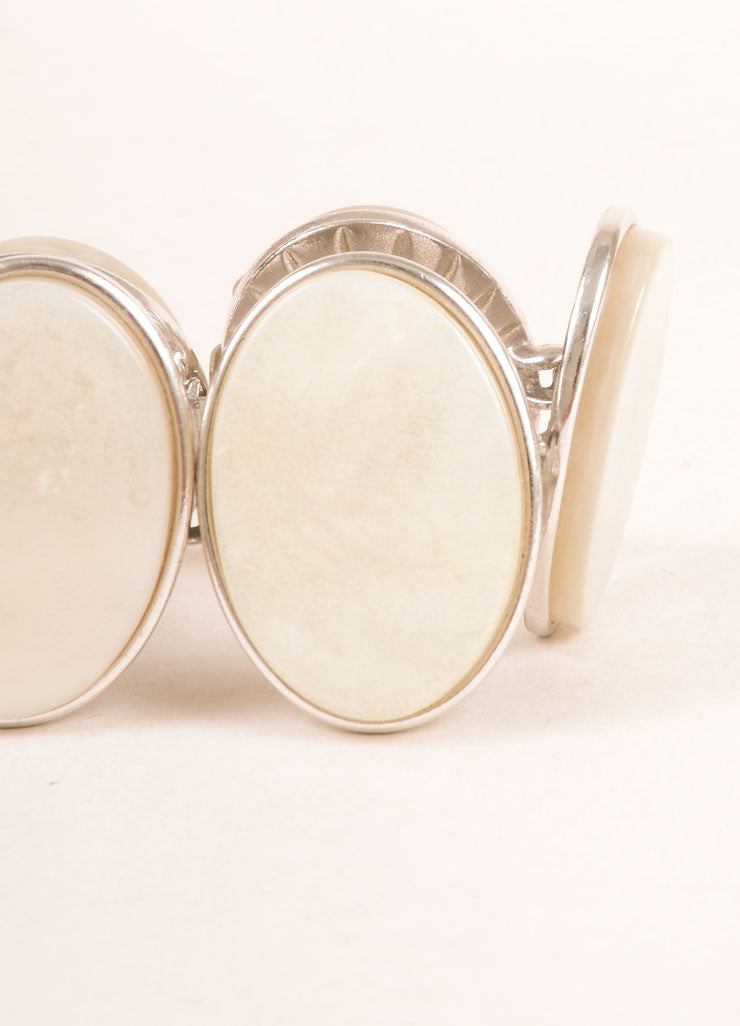 Yves Saint Laurent Silver Toned and Cream Flat Stone Face Oval Bracelet Detail