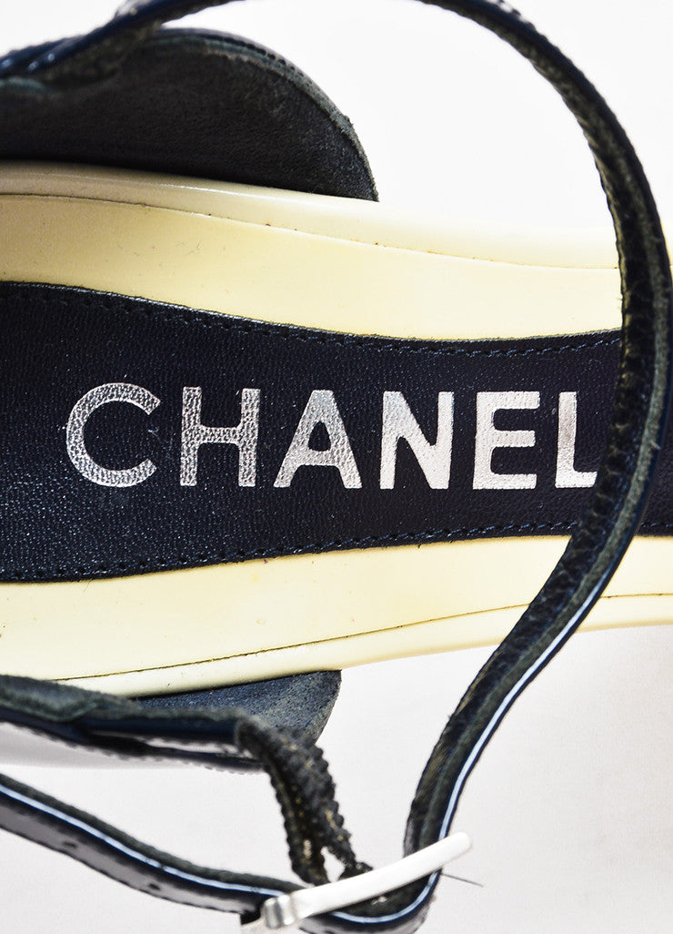 Chanel Navy, Cream, and Silver Toned Heel Cap Patent Leather Platform Wedge Heels Brand