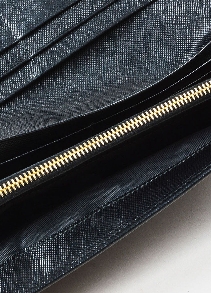 Prada Black Saffiano Leather Gold Toned Metal Trifold Continental Wallet Interior