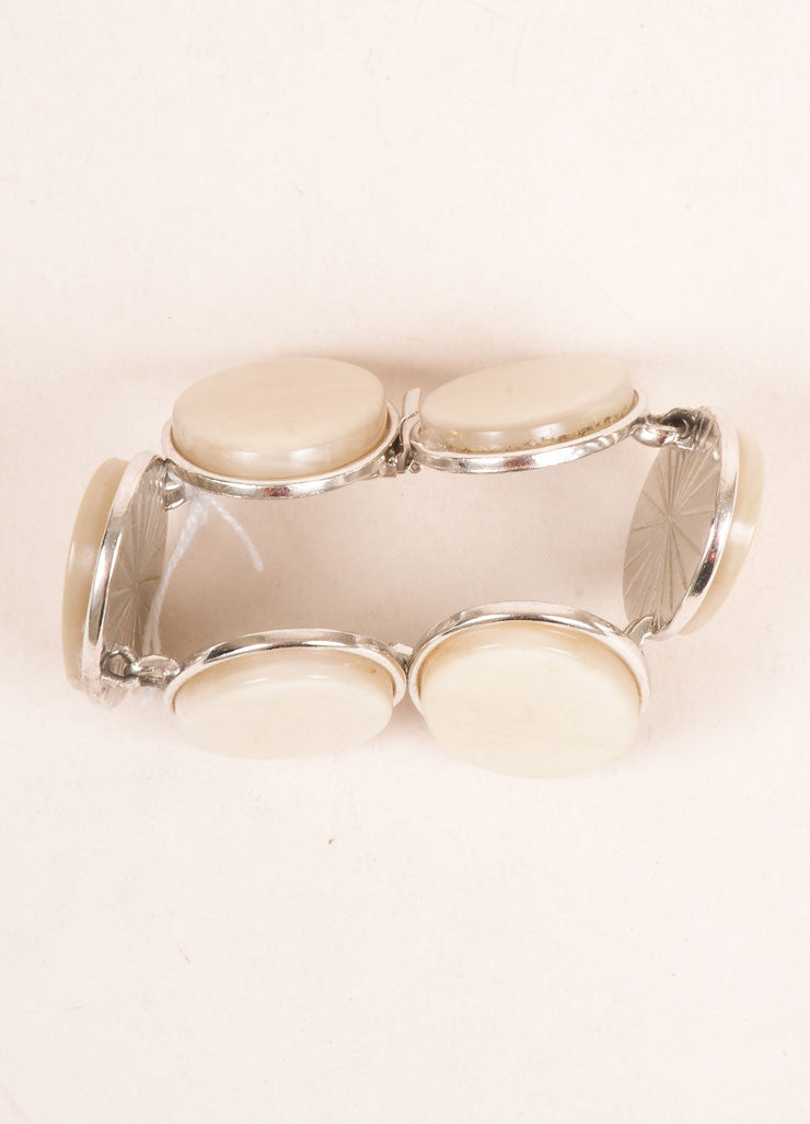 Yves Saint Laurent Silver Toned and Cream Flat Stone Face Oval Bracelet Topview