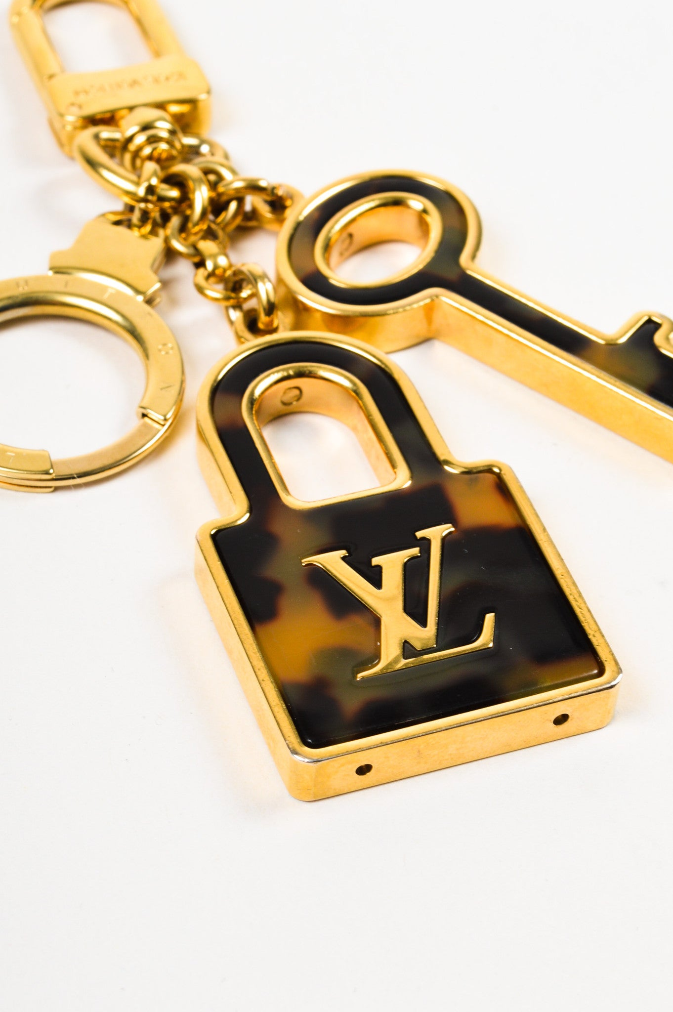 "Louis Vuitton Gold Toned and Tortoise ""Porte Cles Confidence"" Lock Key Bag Charm Sideview"