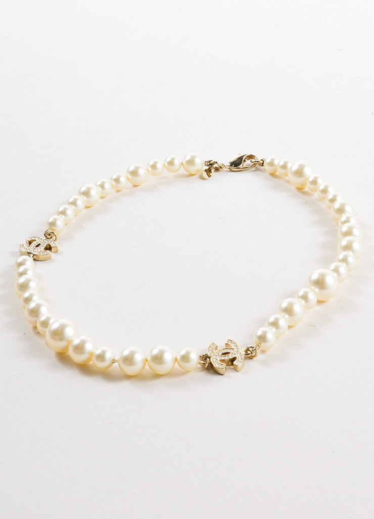 "Chanel Faux Pearl and Gold Toned Rhinestone ""CC"" Logo Necklace Sideview"