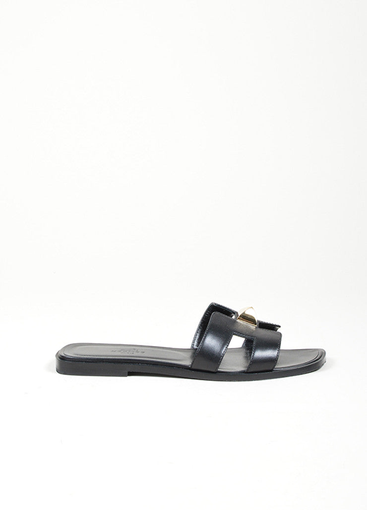 "Black Leather Hermes ""Medor Permabrass Clou Oran"" Flat Sandals Sideview"