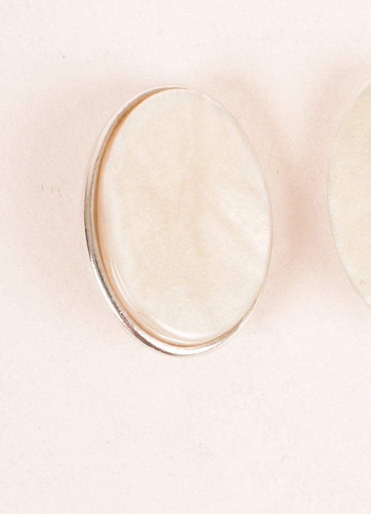 Yves Saint Laurent Silver Toned and Cream Flat Stone Face Oval Earrings Detail