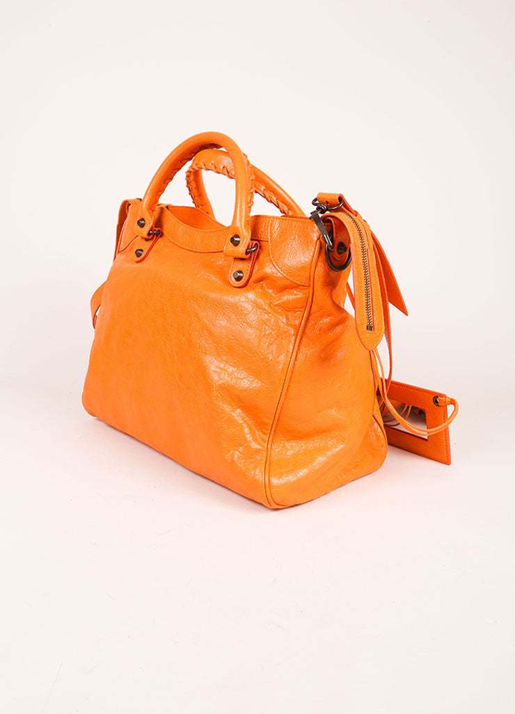 "Balenciaga New With Tags Orange Stud Accent Crossbody ""Velo"" Satchel Bag Sideview"