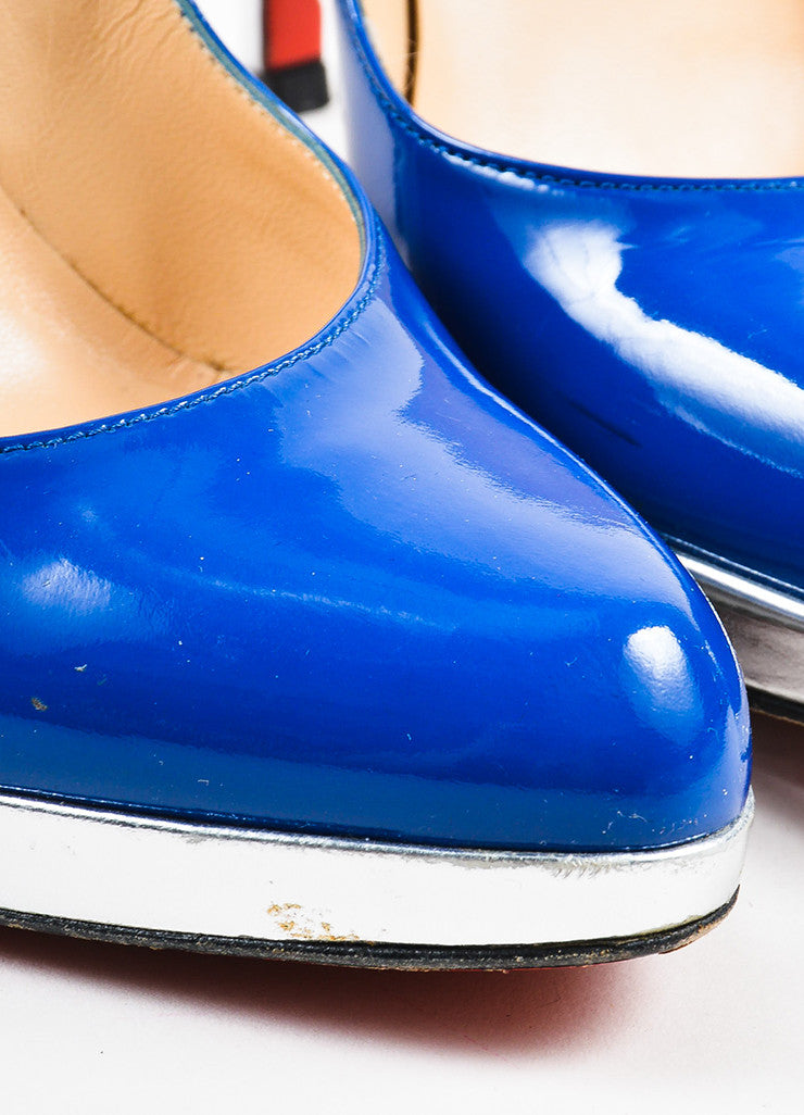 "Christian Louboutin Blue and Silver Patent Leather ""Decolzep"" Pumps Detail"