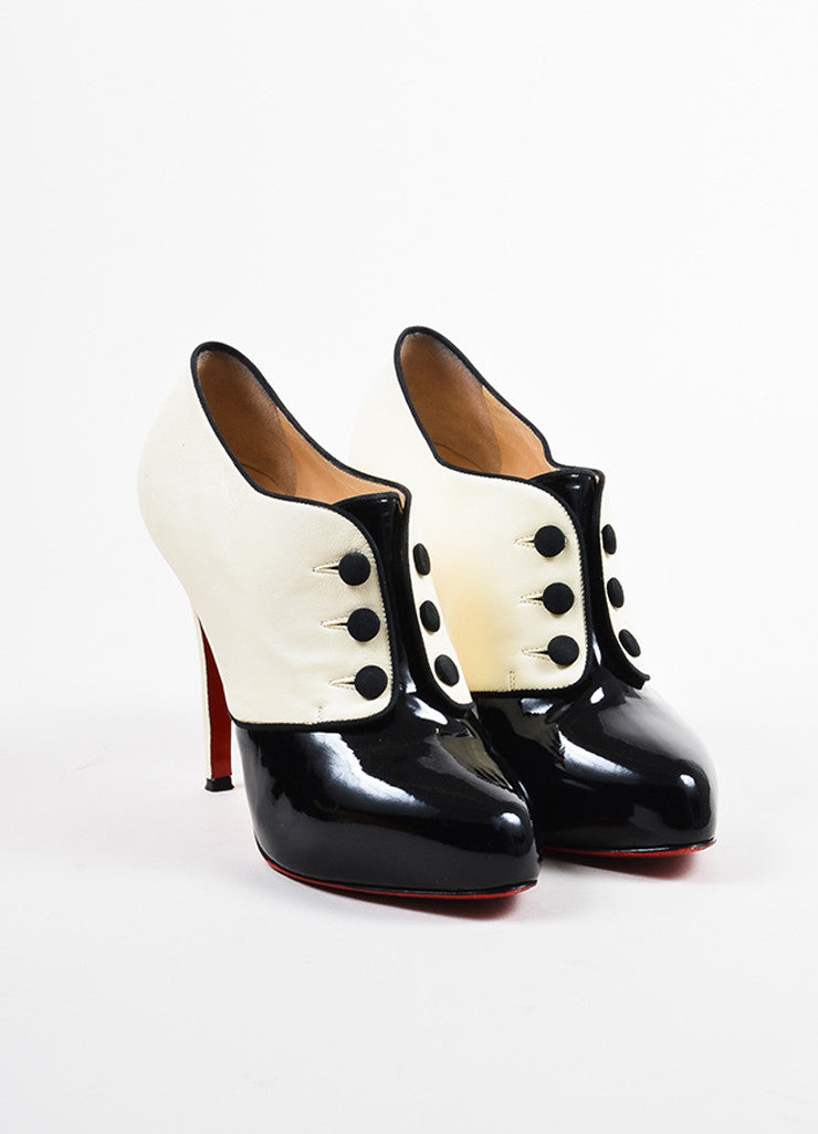 "•ÈÀChristian Louboutin Black and Cream Patent Button ""Esoteri 120"" Heel Booties Frontview"