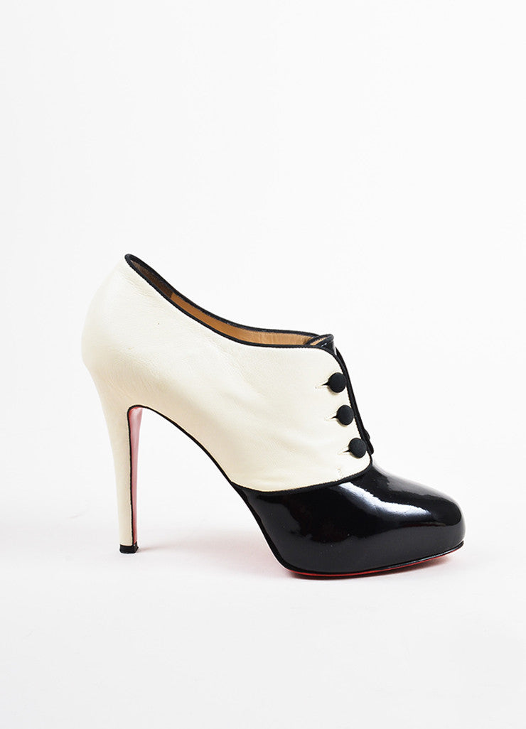 "•ÈÀChristian Louboutin Black and Cream Patent Button ""Esoteri 120"" Heel Booties Sideview"