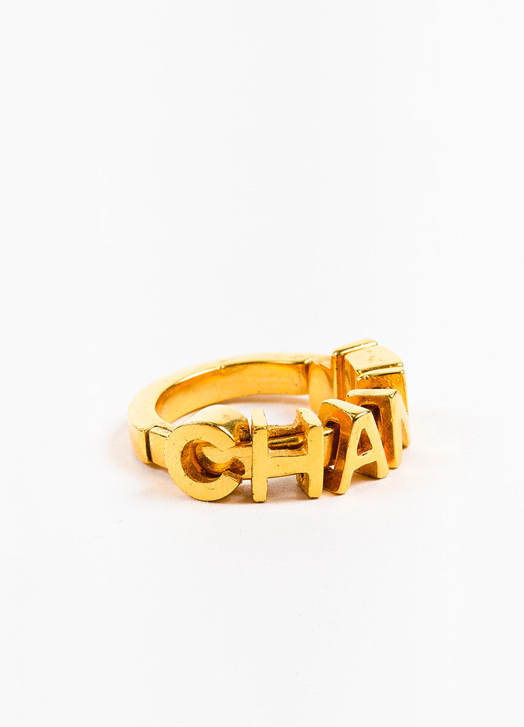 Chanel Gold Toned Charm Letter Embellished Band Ring  Sideview