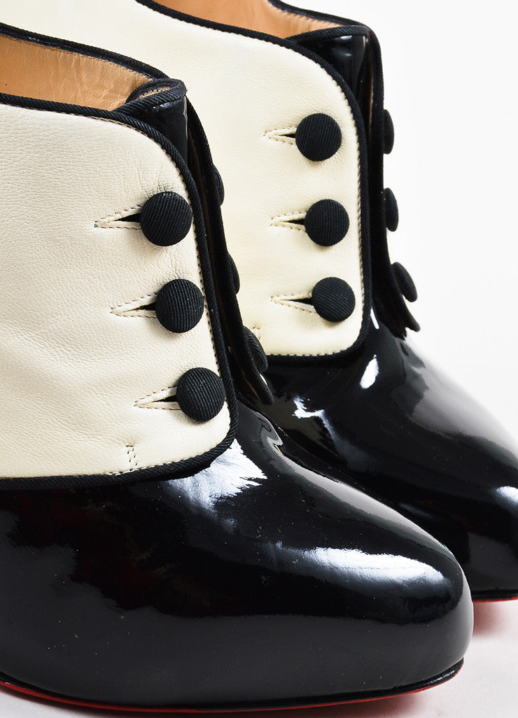 "•ÈÀChristian Louboutin Black and Cream Patent Button ""Esoteri 120"" Heel Booties Detail"