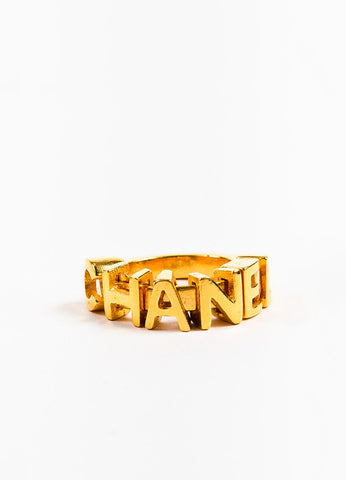 Chanel Gold Toned Charm Letter Embellished Band Ring Frontview